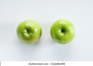 Fresh whole green apples with up and down side on white background