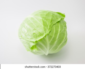 Fresh whole green cabbage isolated put on a white background.