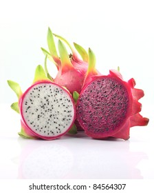 Fresh whole and two half dragon fruit isolated white background. Dragon fruit or Pitaya is the plant in Cactaceae family or Cactus.