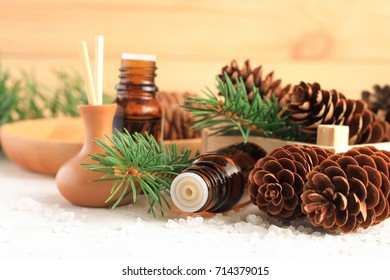 Fresh winter home scent. Medicinal amberglass dropper bottle with green fir-needle and cones, aromalamp diffuser for relaxing healthy spa