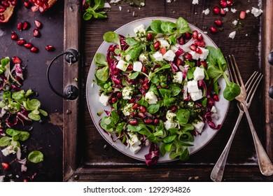 fresh winter salad with pomegranate seeds, lamb's lettuce and radicchio