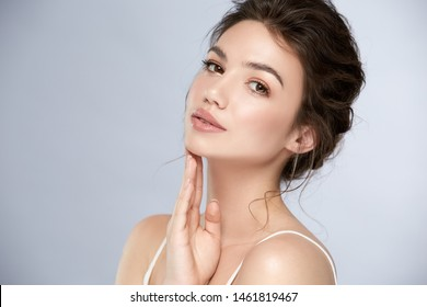 fresh woman face with glossy lipstic and light make-up looking to camera, elegant and natural girl with mua
