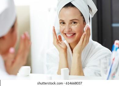 Fresh woman taking care of her eye zone