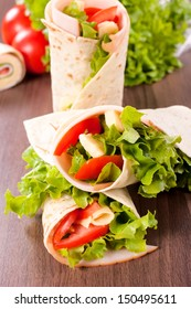 Fresh wrap snadwich with turkey meat and fresh vegetables