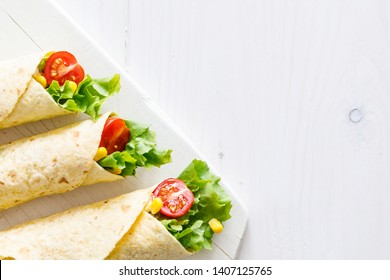 fresh wraps on wooden board with copy space