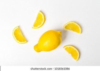 Fresh yellow lemon fruit and lemon slice onwhite background