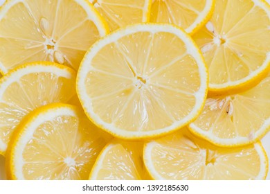 Fresh yellow Lemon slices on the old wooden table.