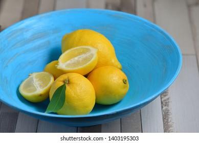 Fresh yellow lemons in blue plate
