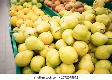 fresh yellow pears in boxes in the store