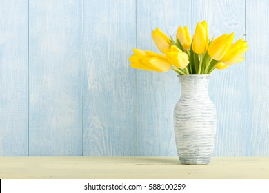 Fresh yellow tulips in a jug