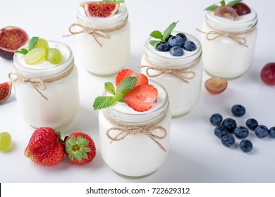 Fresh yogurt. Breakfast with yogurt with fruits and berries. Healthy food concept. Top view. Copy space