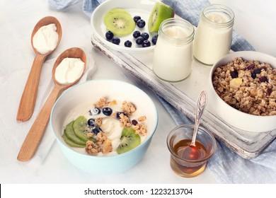 Fresh yogurt on white table. Probiotic dairy drink