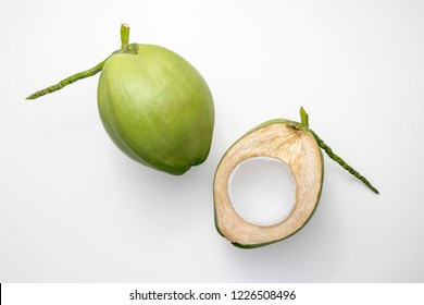 Fresh young coconuts on a white background, creative flat lay healthy food concept, top view with clipping path