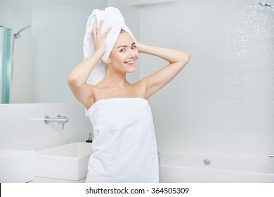 Fresh Young Woman Wrapped with Towels After Bath, Smiling at the Camera