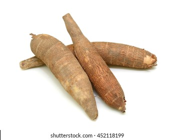 Fresh yucca (cassava) roots isolated on white