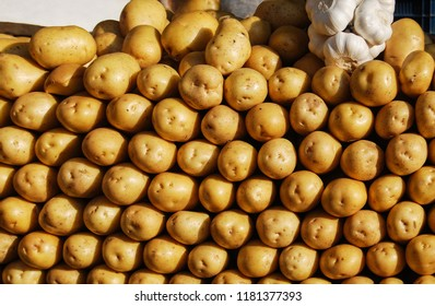 Fresh yyoung potatoes on market. Vegetables background.