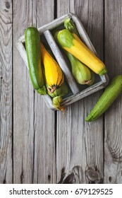 Fresh zucchini in box on a wooden table