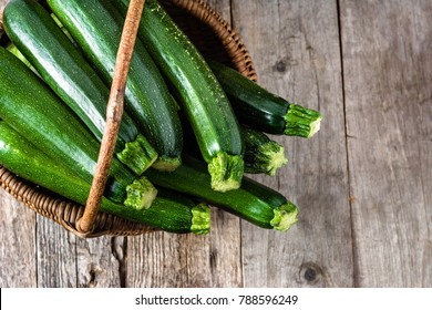 Fresh zucchini, green vegetables on local farmer market, freshly harvested courgette, summer squash