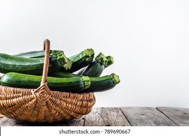 Fresh zucchini, green vegetables on farmer market, eco produce freshly harvested from the garden