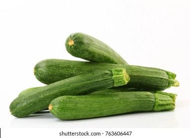 a fresh zucchini on white background