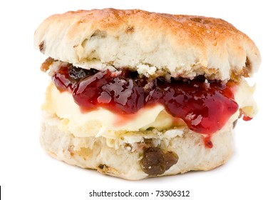 Fresh-baked scone, with strawberry jam and clotted cream. Isolated on white. Happy Days!
