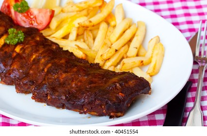 fresh-BBQ marinated spareribs and french fries