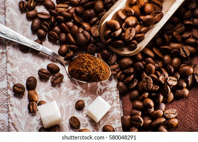 Fresh-ground coffee beans.Coffee beans on wooden texture