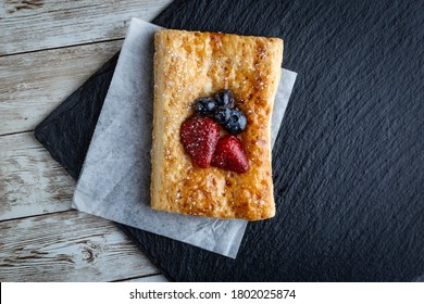 Freshly backed puff pastry with strawberries and blueberries.