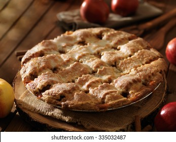 freshly baked apple pie with lattice design shot close up with selective focus