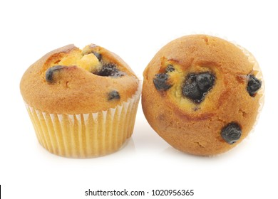 freshly baked blueberry muffins on a white background