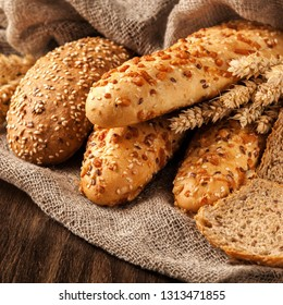 freshly baked bread assortment on wooden board. food concept.