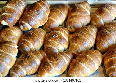 Freshly baked bread buns in a tray