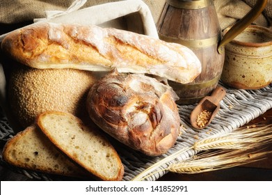 Freshly baked bread with jug in countryside setting