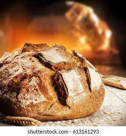 Freshly baked bread in rustic bakery with traditional oven. Food background