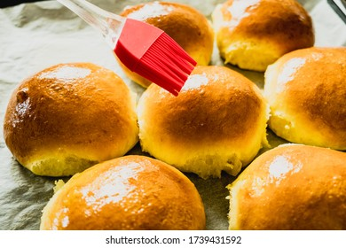 Freshly baked buns glazed with melted butter