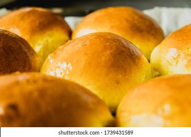 Freshly baked burger buns close up