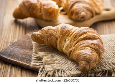 Freshly baked butter croissant. Studio photo.