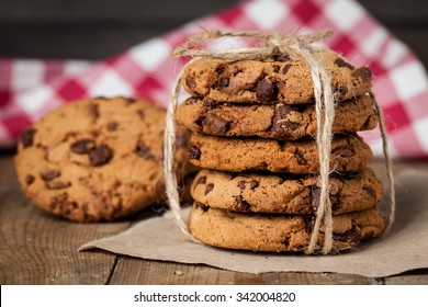 freshly baked chocolate chip cookies on rustic wooden table