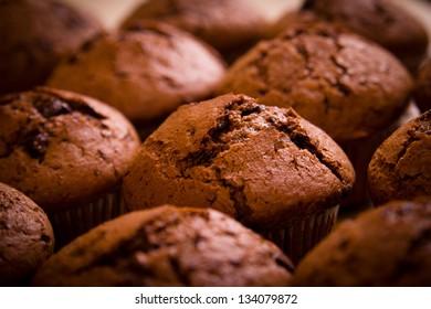 Freshly baked chocolate muffins closeup shoot