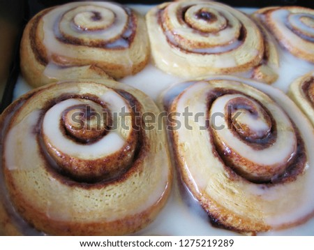 Freshly baked cinnamon rolls dripping with white icing