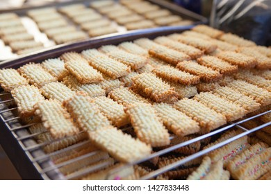 Freshly baked cookies cooling off on metal grid