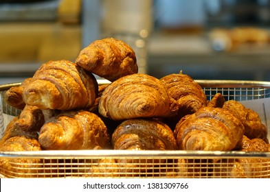 Freshly baked croissant buns in a tray