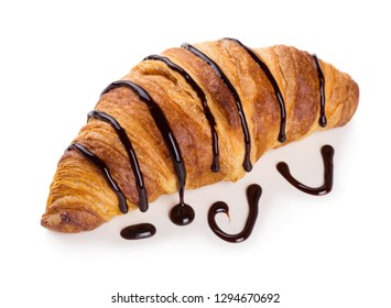 Freshly baked croissant decorated with chocolate sauce