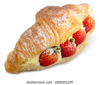 Freshly baked croissant stuffed with fresh strawberries and pastry cream on white background. Clipping path.