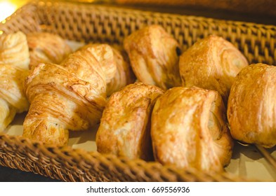 Freshly baked croissants in the basket