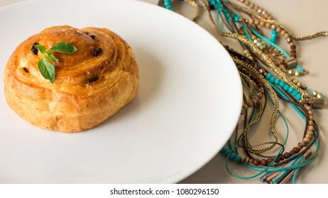 Freshly baked danish on white plate.