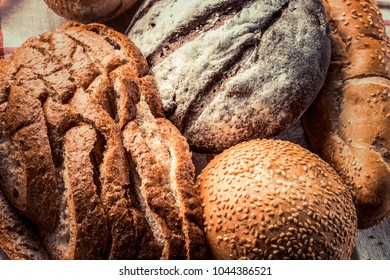Freshly baked different types of bread - food background