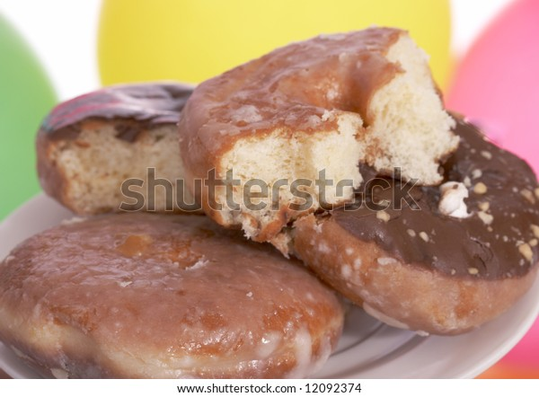 freshly baked donuts on a white background