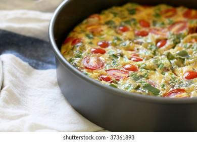 A freshly baked egg, tomato and green pepper frittata