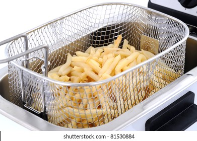 Freshly baked french fries in an electric frying pan basket
